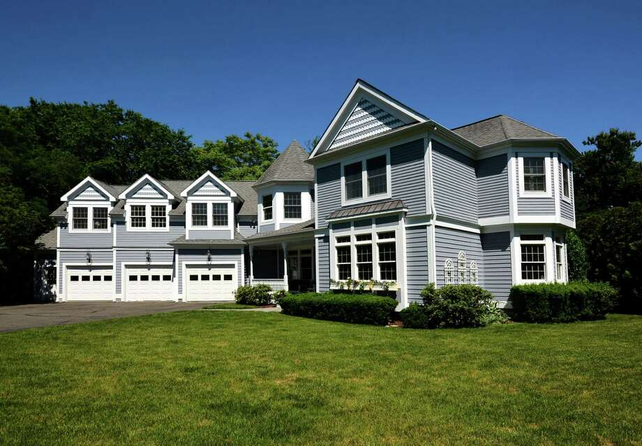 The property at 7 Fresh Meadows Lane has a price tag of $1,545,000. Photo: Contributed Photo / Darien News