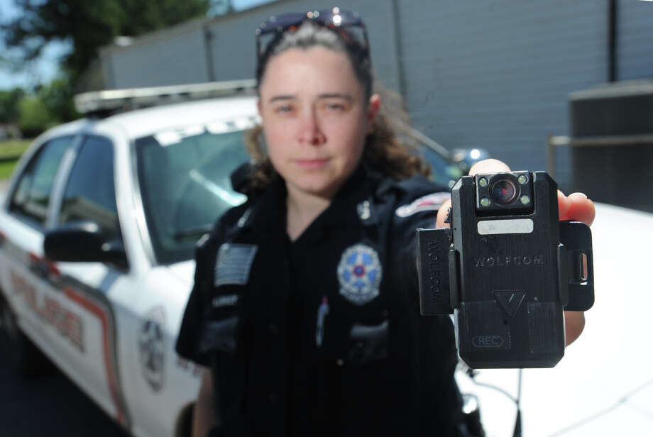 Kountze Police Officer Kiera Linney holds out the body camera, Tuesday, that she uses during patrol. While Kountze is currently working to purchase body cameras, Linney and her fellow officers have purchased their own cameras to wear while on duty.  Photo taken Tuesday, April 21, 2015  Guiseppe Barranco/The Enterprise Photo: Guiseppe Barranco, Photo Editor