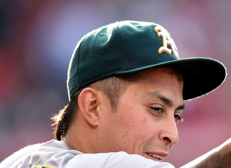 ANAHEIM, CA - APRIL 23:  Jesse Chavez #30 of the Oakland Athletics watches play from the dugout during the bottom of the bottom of the sixth inning against the Los Angeles Angels at Angel Stadium of Anaheim on April 23, 2015 in Anaheim, California.  (Photo by Harry How/Getty Images) Photo: Harry How, Getty Images