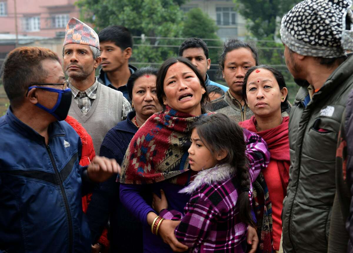 TOPSHOTS A Nepalese resident mourns the death of a relative following an earthquake in Kathmandu on April 26, 2015. International aid groups and governments intensified efforts to get rescuers and supplies into earthquake-hit Nepal on April 26, 2015, but severed communications and landslides in the Himalayan nation posed formidable challenges to the relief effort. As the death toll surpassed 2,000, the US together with several European and Asian nations sent emergency crews to reinforce those scrambling to find survivors in the devastated capital Kathmandu and in rural areas cut off by blocked roads and patchy phone networks. AFP PHOTO / PRAKASH MATHEMAPRAKASH MATHEMA/AFP/Getty Images