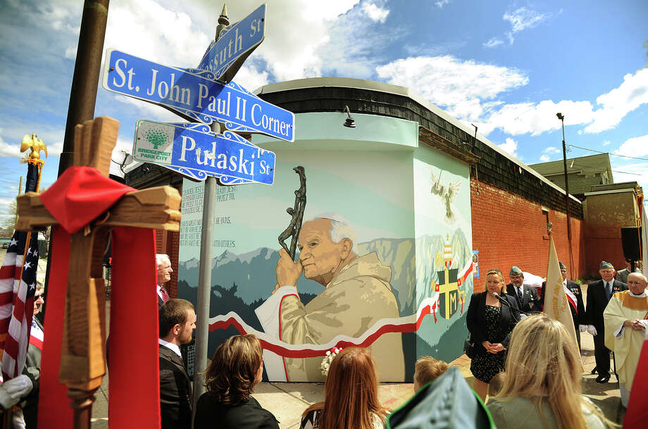 Polish Consul General Urszula Gacek addresses the crowd during the unveiling of a mural of former Polish pope and now Saint John Paul II at the corner of Kossuth and Pulaski Streets in Bridgeport, Conn. on Sunday, April 26, 2015. The corner has been named St. John Paul II Corner. Photo: Brian A. Pounds / Connecticut Post