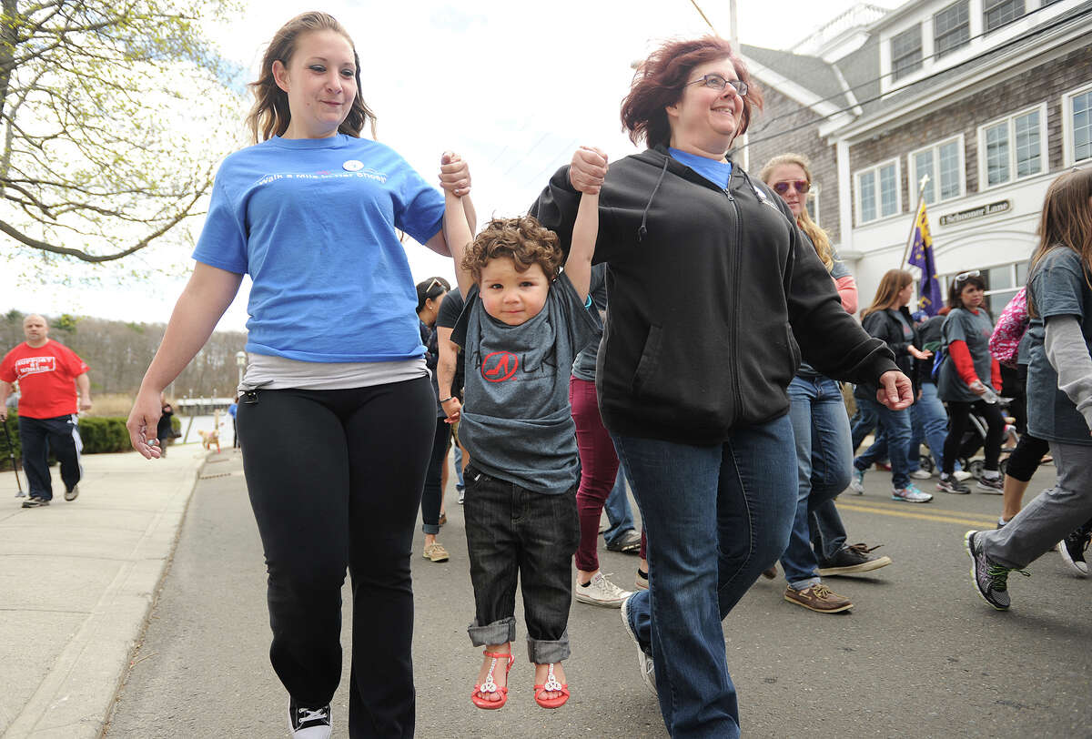 The annual Walk A Mile In Her Shoes event at Lisman Landing on Factory Lane in Milford, Conn. on Sunday, April 26, 2015.
