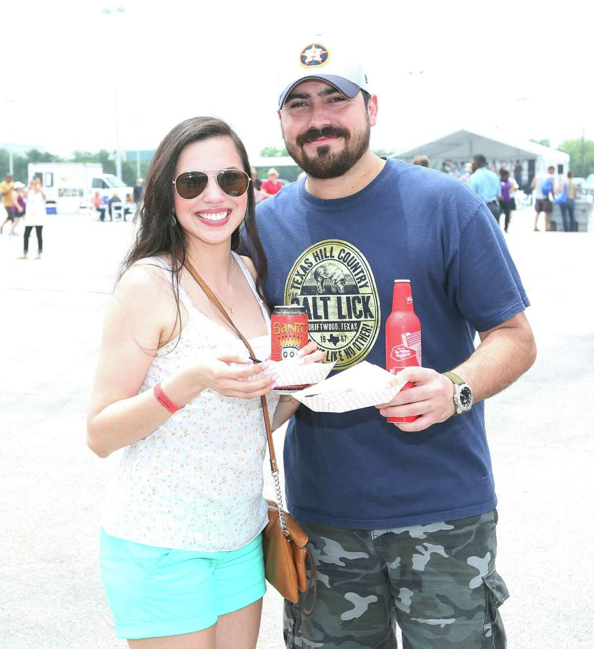 Guests pose for a photo at the 3rd annual Houston Barbecue Festival Sunday, April 26, 2015, at NRG Park.