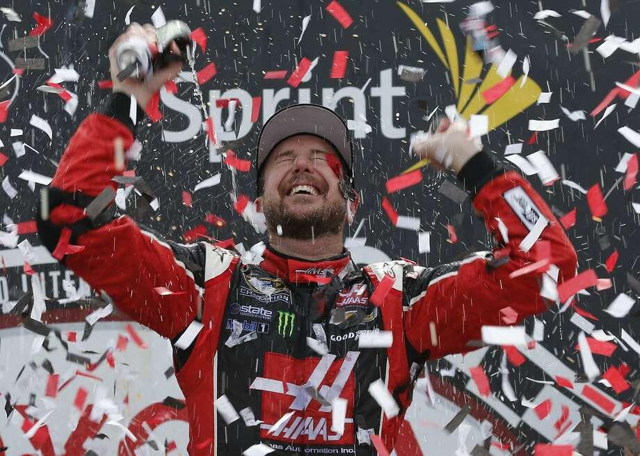 Kurt Busch celebrates after winning the NASCAR Sprint Cup auto race at Richmond International Raceway in Richmond, Va., Sunday, April 26, 2015. (AP Photo/Steve Helber) Photo: Steve Helber, Associated Press