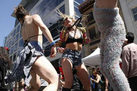 (From left) Kristina Altman, Anya Litvinova and Scott Munson dance on a platform during the annual How Weird Street Festival on Howard Street in San Francisco, Calif. Sunday, April 26, 2015.