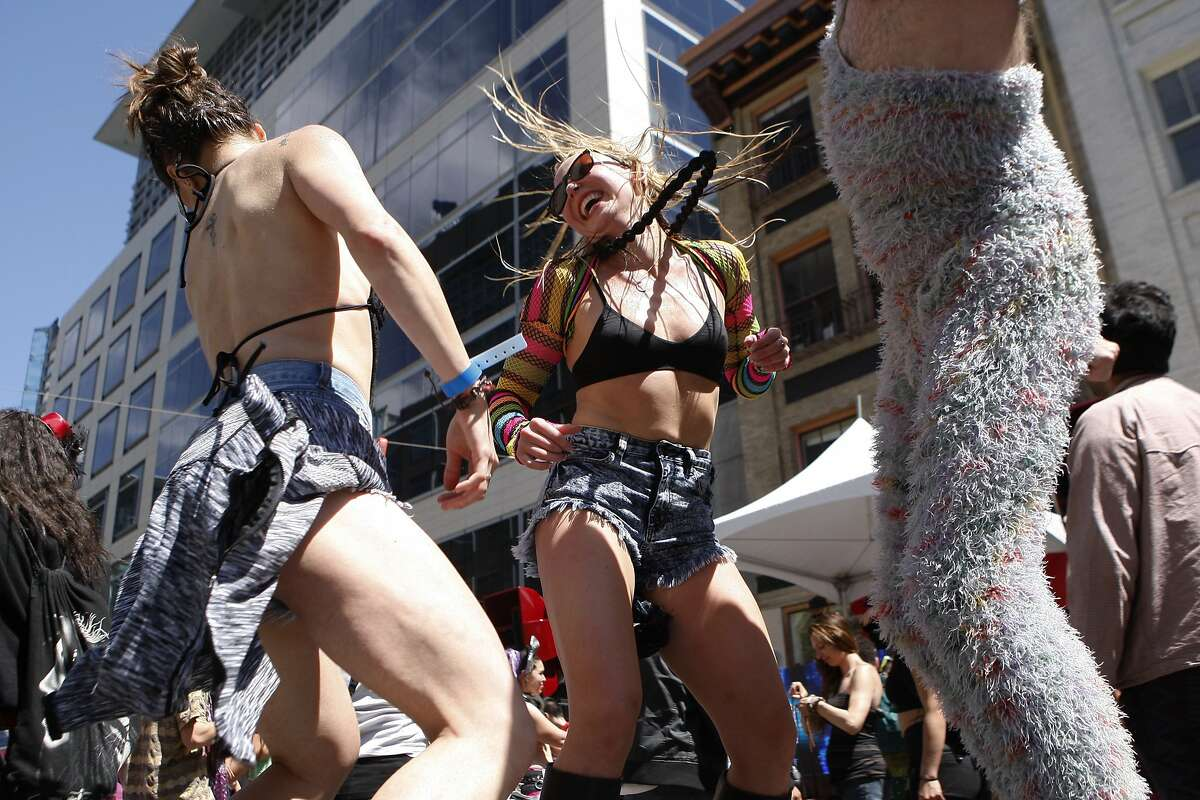 (From left) Kristina Altman, Anya Litvinova and Scott Munson dance on a platform during the annual How Weird Street Festival on Howard Street in San Francisco, Calif. Sunday, April 26, 2015.