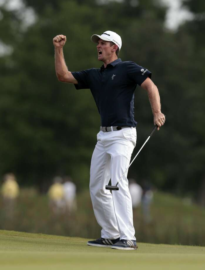 Justin Rose, of England, celebrates after making a birdie putt on the 18th hole during the final round of the Zurich Classic PGA golf tournament, Sunday, April 26, 2015, in Avondale, La. Rose won the tournament. (AP Photo/Butch Dill) Photo: Butch Dill, Associated Press