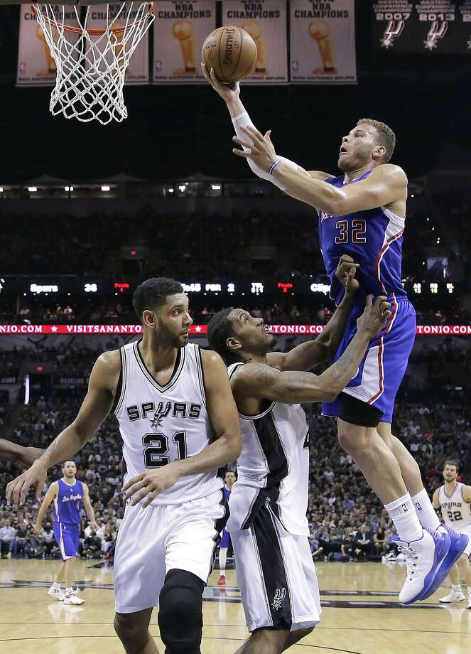 Blake Griffin, who had 20 points and 19 rebounds, scores over San Antonio's Kawhi Leonard and Tim Duncan (21). Photo: Darren Abate, Associated Press