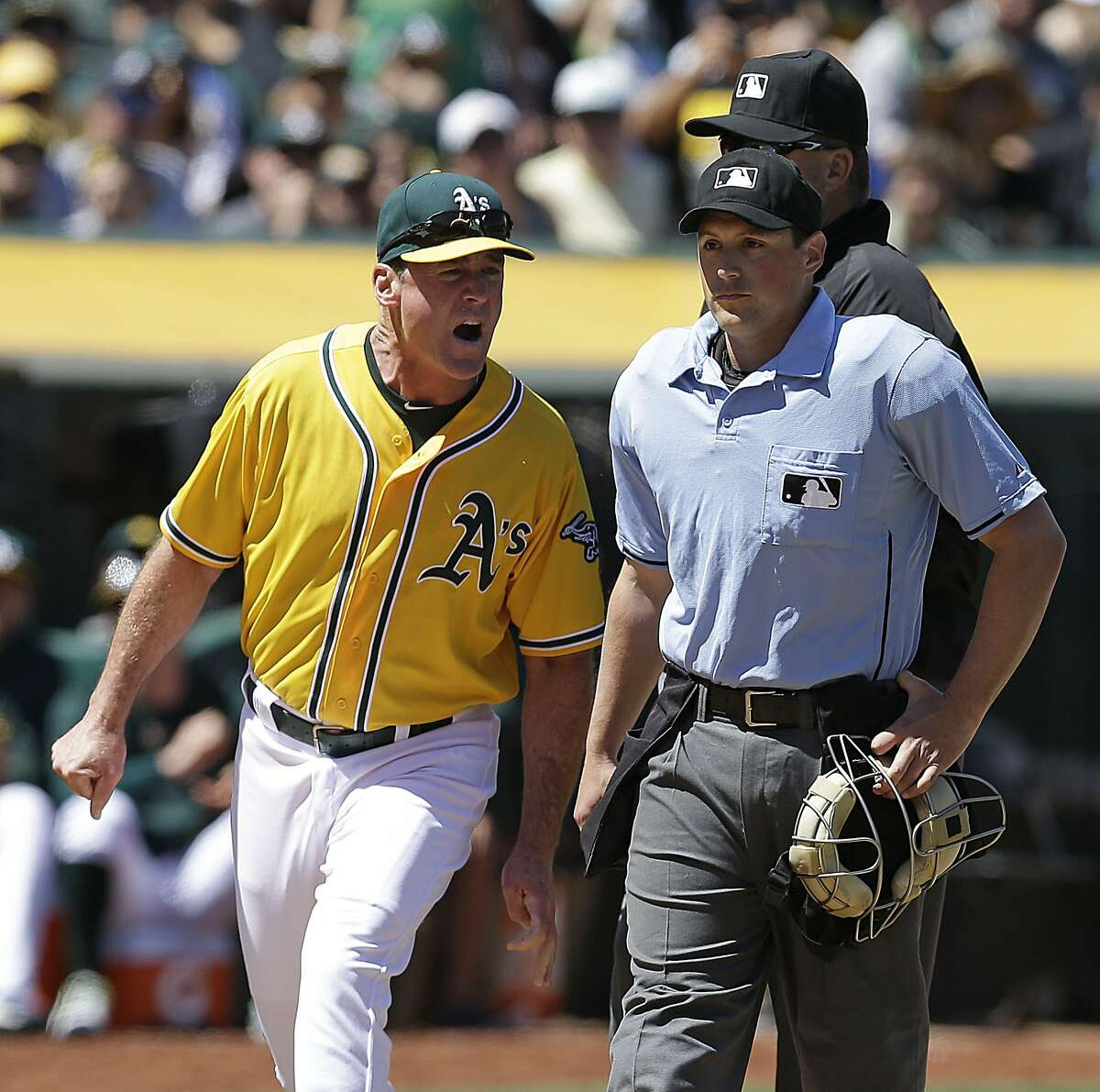 Oakland Athletics manager Bob Melvin, left, yells at home plate umpire Quinn Wolcott after being ejected in the fourth inning of a baseball game against the Houston Astros, Sunday, April 26, 2015, in Oakland, Calif. (AP Photo/Ben Margot)