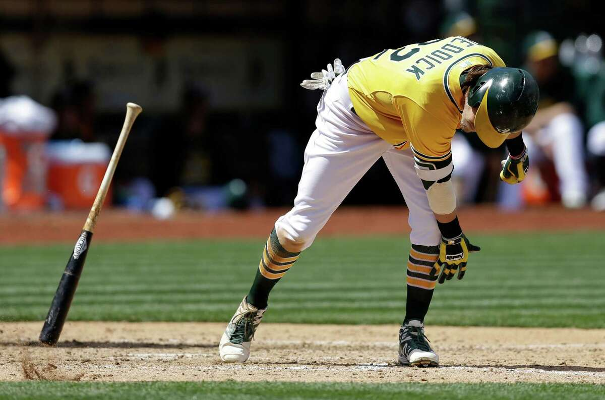 Oakland Athletics' Josh Reddick throws his bat after hitting a fly-out in the fourth inning of a baseball game against the Houston Astros, Sunday, April 26, 2015, in Oakland, Calif. (AP Photo/Ben Margot)