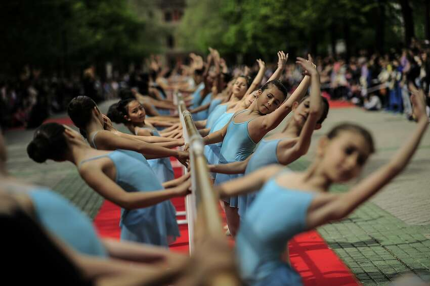 Classic dancers perform on the street during Dance Day, in Pamplona northern Spain, Saturday, April 25, 2015.