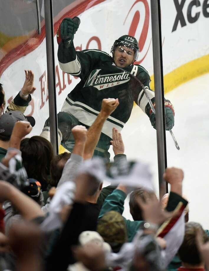 Minnesota's Zach Parise celebrates after scoring a third-period goal. Photo: Hannah Foslien, Getty Images