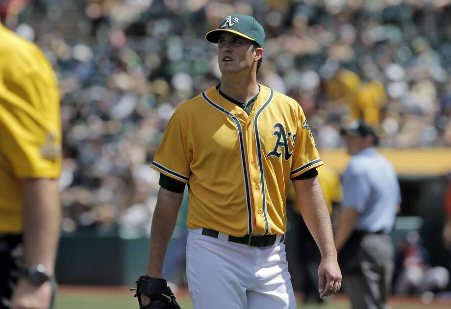 A's starter Drew Pomeranz walks off the field after giving up the lead on a Jake Marisnick two-run homerun. The Oakland Athletics played the Houston Astros at O.co Coliseum in Oakland, Calif., on Sunday, April 26, 2015. The Astros won 7-6. Photo: Carlos Avila Gonzalez, The Chronicle