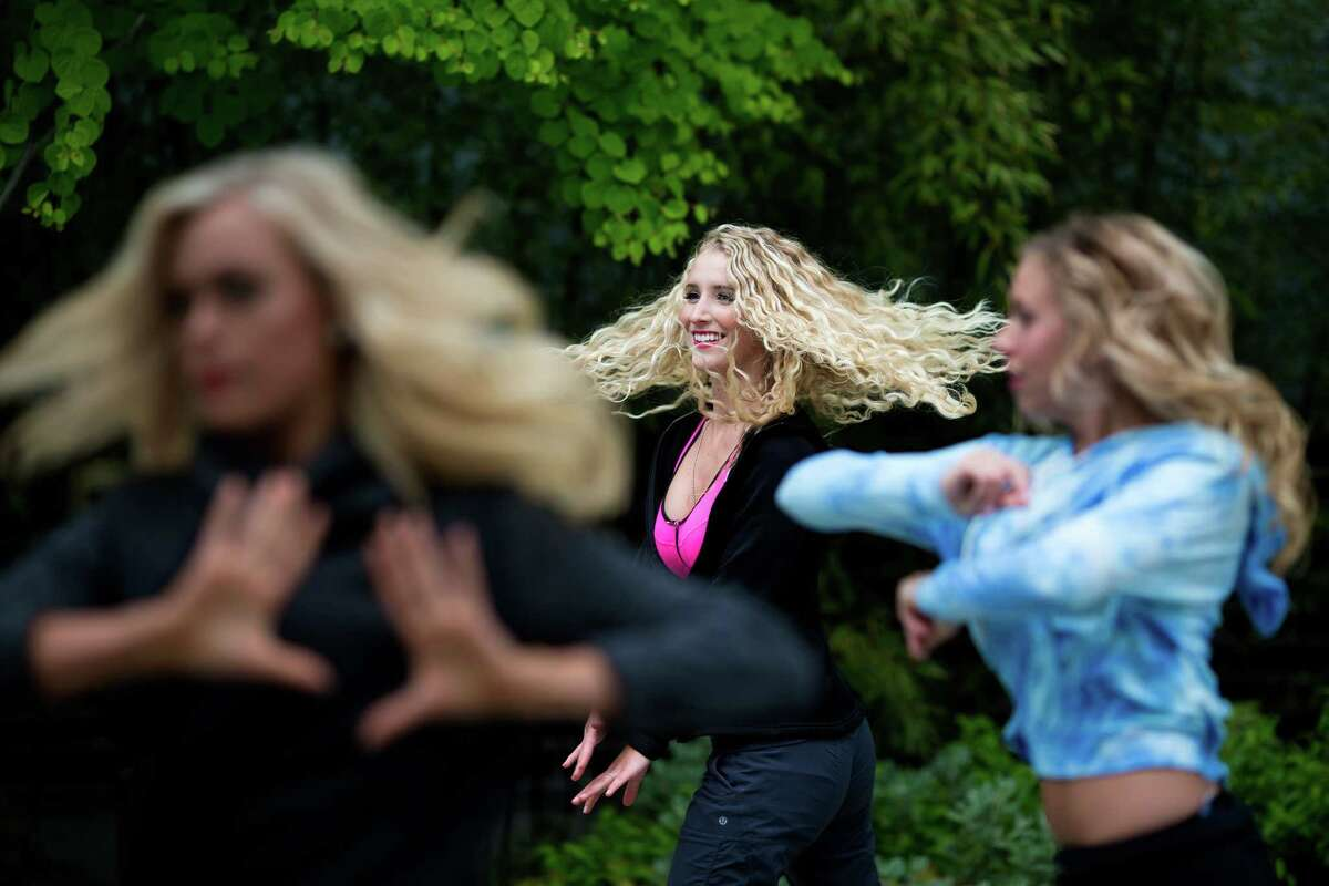 Young women warm up outside of the VMAC before the secondary round of the selection process for the upcoming Sea Gals squad Sunday, April 26, 2015, in Renton, Washington. Contestants were judged on dance ability, pizzazz and physical appearance. Some 50 women returned after a first round elimination the day before, competing for a limited number of spots through rehearsed dance and interviews.