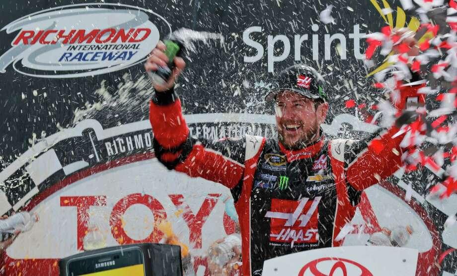 Kurt Busch celebrates after winning the NASCAR Sprint Cup auto race at Richmond International Raceway in Richmond, Va., Sunday, April 26, 2015. (AP Photo/Steve Helber) ORG XMIT: VASH115 Photo: Steve Helber / AP