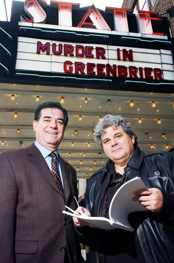 """Stamford Mayor Michael Pavia and Frank Petrilli, left to right, co-writers of the original screenplay """"Murder In Greenbrier"""" posed in front of the State Cinema in Stamford, Conn. on Friday, March 5, 2010.  Although the movie has yet to be produced in full length, the duo hopes to eventually achieve what is illustrated above them, their movie up on the marquee and featured in the theater. Photo: Kathleen O'Rourke, Kathleen O'Rourke/Illustrated Photo / Stamford Advocate"""