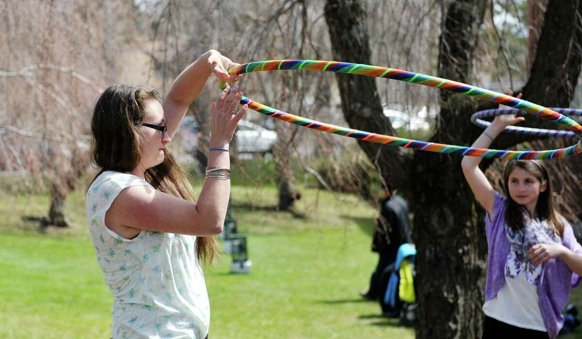Jennifer Mapes, owner of Hoops by Jem, demonstrates how to get an arm workout with a hula hoop at the The 23rd annual Cherry Blossom Festival, put on by the Congregation Gates of Heaven on Sunday, April 26, 2015, in Schenectady, N.Y. The money raised through the 5K race and the 2K walk benefit the St. Peters Regional ALS Center. (Paul Buckowski / Times Union)