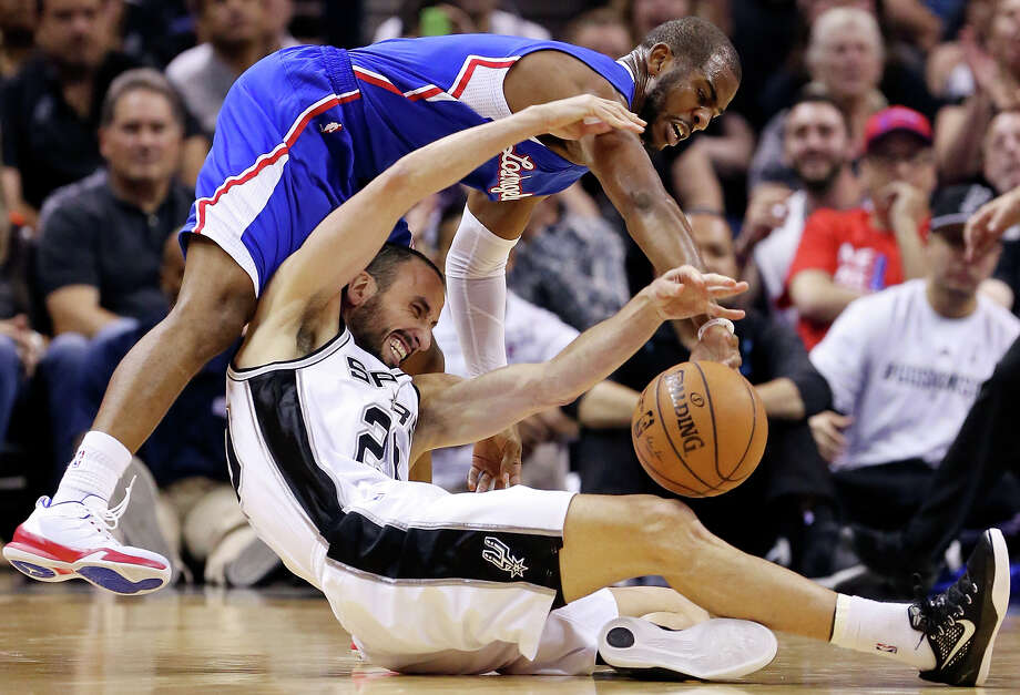 Los Angeles Clippers' Chris Paul and San Antonio Spurs' Manu Ginobili chase after a loose ball during first half action of Game 4 in the Western Conference playoffs Sunday April 26, 2015 at the AT&T Center. Photo: Edward A. Ornelas /San Antonio Express-News / © 2015 San Antonio Express-News