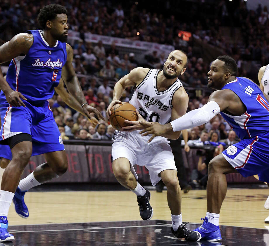 San Antonio Spurs' Manu Ginobili drives between Los Angeles Clippers' DeAndre Jordan (left) and Glen Davis during first half action of Game 4 in the Western Conference playoffs Sunday April 26, 2015 at the AT&T Center. Photo: Edward A. Ornelas, Staff / San Antonio Express-News / © 2015 San Antonio Express-News