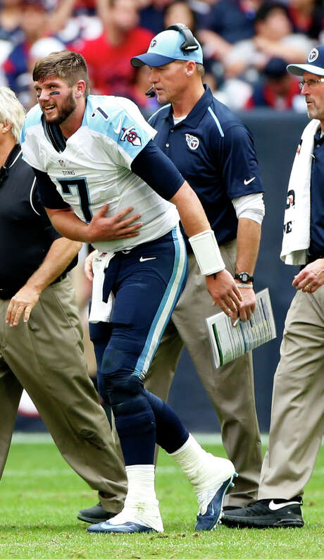 The top of the first round of the draft could swing on a sixth-round pick from 2014, as Titans coach Ken Whisenhunt, right, has to decide if he has enough faith in Zach Mettenberger (7) or prefers Marcus Mariota as the team's solution at quarterback. Photo: Karen Warren, Staff / © 2014 Houston Chronicle