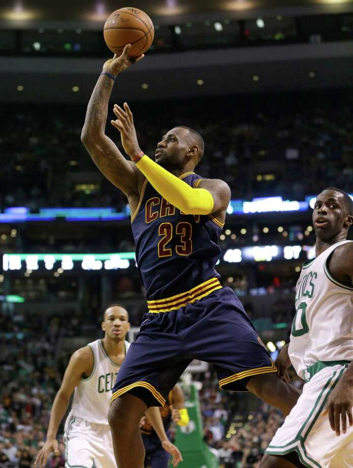 Cleveland Cavaliers forward LeBron James, center, takes a shot at the basket as Boston Celtics guard Avery Bradley, left, and forward Brandon Bass, right, look on in the third quarter of a first-round NBA playoff basketball game in Boston, Sunday, April 26, 2015. The Cavaliers won 101-93 to complete a first-round sweep of the Celtics. (AP Photo/Steven Senne) ORG XMIT: MASR108 Photo: Steven Senne / AP