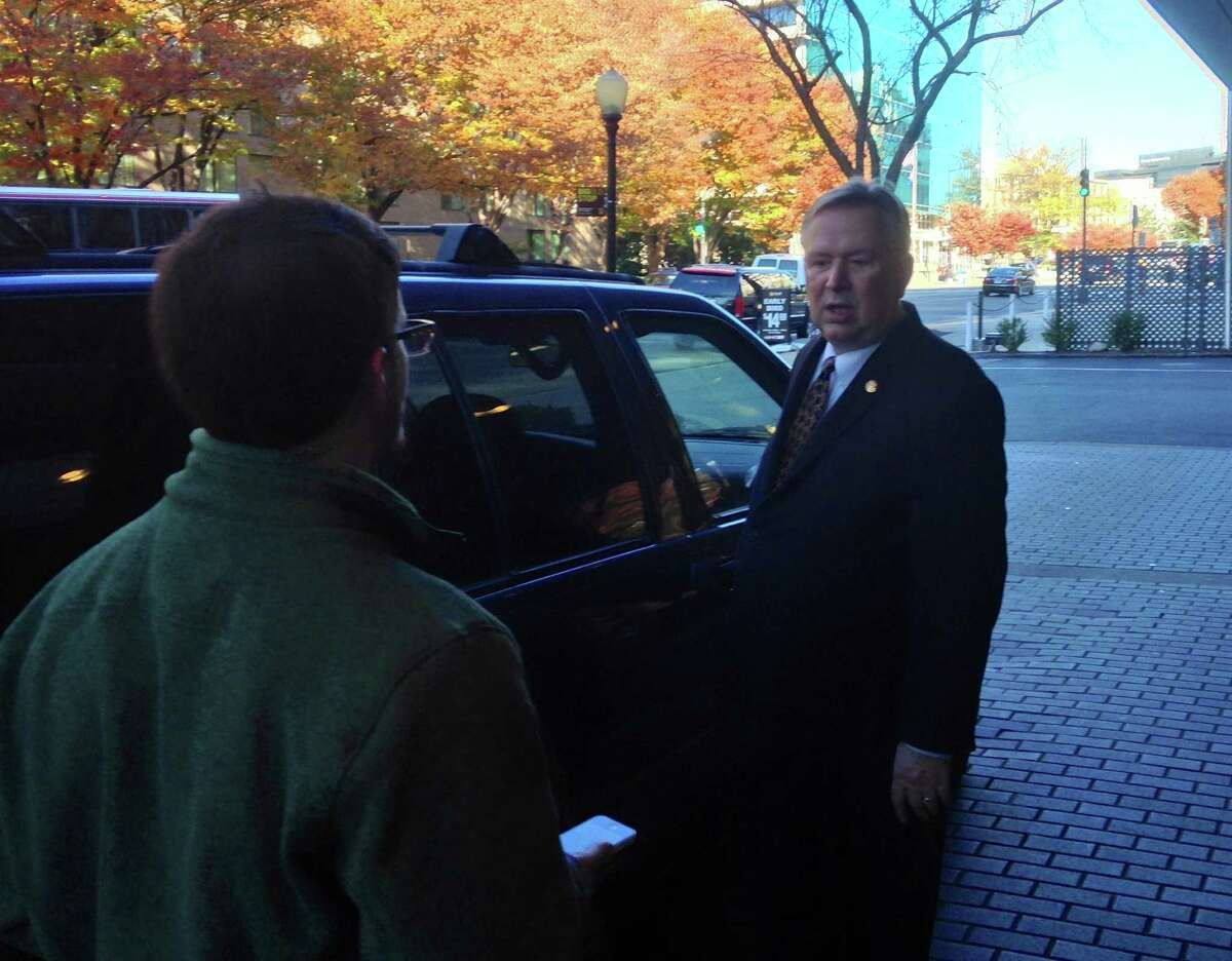 Rep. Steve Stockman talks with a reporter after a Washington, D.C. fundraiser for his campaign Nov. 13, 2013.