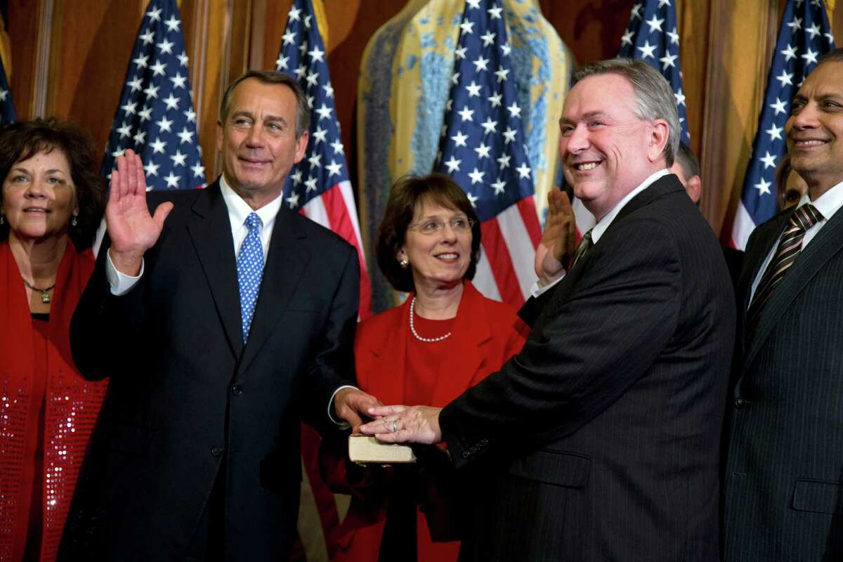 In this Jan. 3, 2013 file photo, Rep. Steve Stockman, R-Texas, second from right, participates in a mock swearing-in ceremony with Speaker of the House Rep. John Boehner, R-Ohio, for the 113th Congress in Washington. Stockman shocked the political world by filing a last-minute Republican primary challenge Monday, Dec. 9, 2013 against incumbent U.S. Sen. John Cornyn. Cornyn is the Senate's minority whip and had appeared likely to escape a major primary challenge from the tea party or other conservative factions. (AP Photo/ Evan Vucci, File)