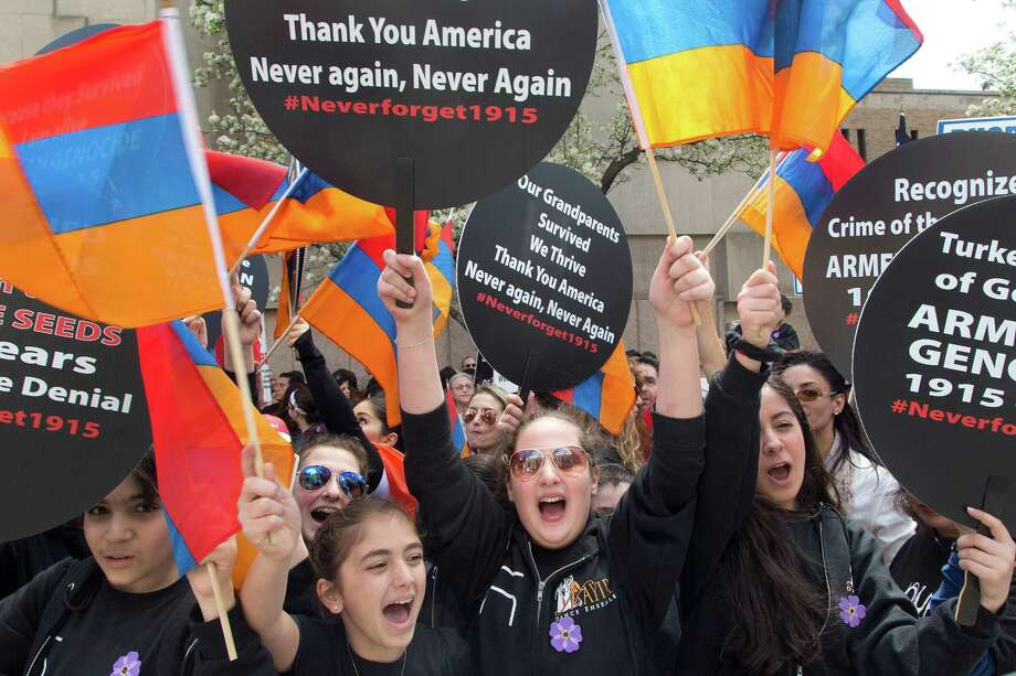 Armenian-Americans march in midtown Manhattan in New York to mark the centennial of the killings of as many 1.5 million Armenians under the Ottoman Empire _ today's Turkey _ on Sunday, April 26, 2015. Pro-Armenian activists are demanding that the U.S. government acknowledge the deaths during World War I as genocide. (AP Photo/Mark Lennihan) ORG XMIT: NYML102 Photo: Mark Lennihan / AP