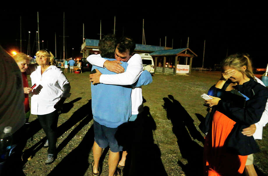 A well-wisher hugs regatta participant Robert Luiten, left, after he learned  that his 18-year-old son was rescued several hours after their boat capsized. Photo: Mike Kittrell, MBI / AL.com