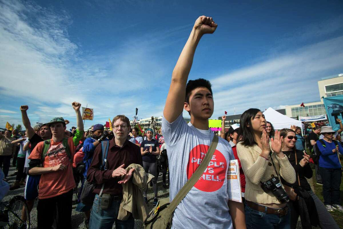Protesters rally against the planned arrival of Shell's oil drilling rig at Myrtle Edwards Park on Sunday, April 26, 2015. Hundreds gathered for the