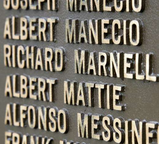 Detail of the Southside Veterans Memorial bearing the name of Richard Marnell, a decorated WWII veteran from Amsterdam Thursday April 23, 2015 in Amsterdam, NY.  (John Carl D'Annibale / Times Union) Photo: John Carl D'Annibale / 00031577A