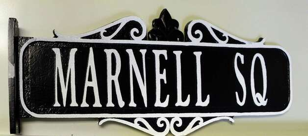 The new Marnell Square sign to recognize the late Richard Marnell, a decorated WWII veteran from Amsterdam, at City Hall Thursday April 23, 2015 in Amsterdam, NY.  (John Carl D'Annibale / Times Union) Photo: John Carl D'Annibale / 00031577A
