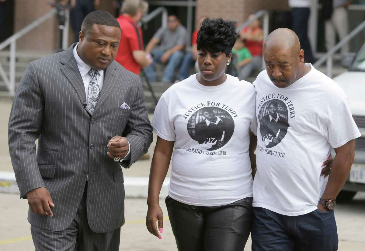 Terry Goodwin's parents Mashell and Dennis Lambert joined Quanell X, left, at a news conference Sunday outside the county jail.