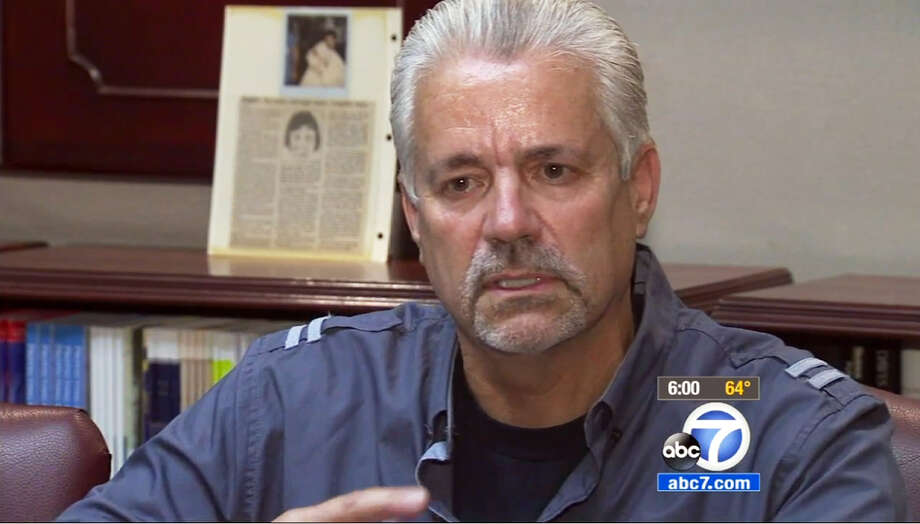 In this April 24, 2015 still from video provided by KABC-TV, retired Santa Ana, Calif., police officer Michael Buelna talks about Robin Barton, now 25, after they are reunited in Santa Ana for the first time since Buelna found Barton as a newborn abandoned in a garbage dumpster. Buelna was on duty on Nov. 21, 1989 when he heard a faint sound coming from a behind a trash bin, sifted through the trash and discovered a baby, his umbilical cord still attached. The child was just four hours old and weighed 4 pounds, 2 ounces. Buelna wanted to adopt him but another Orange County family stepped in first.(KABC-TV via AP)  MANDATORY CREDIT   TV OUT Photo: TEL / KABC-TV