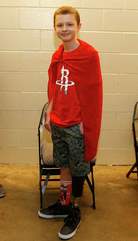 Sammy Day was outside the Rockets' locker room before he rooted for his favorite team in Game 4 on Sunday. Photo: James Nielsen, Staff / © 2015  Houston Chronicle