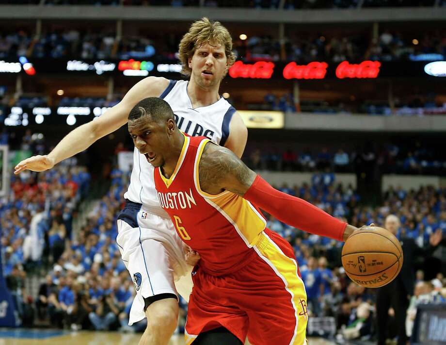 Rockets forward Terrence Jones, who had 13 points, makes a move on Dirk Nowitzki during the first half of Game 5 on Sunday night. Photo: James Nielsen, Staff / © 2015  Houston Chronicle