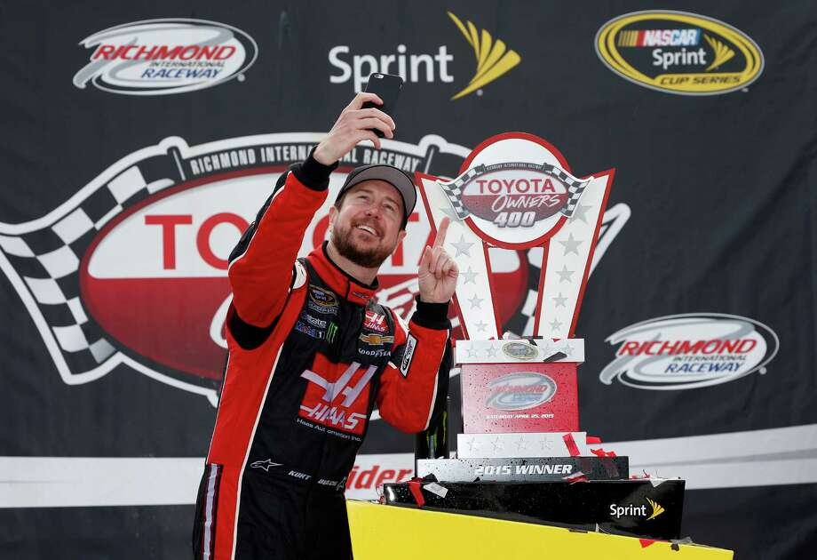 Kurt Busch makes sure he captures Sunday's good time that followed a tumultuous last several months. Photo: Todd Warshaw, Stringer / 2015 Getty Images