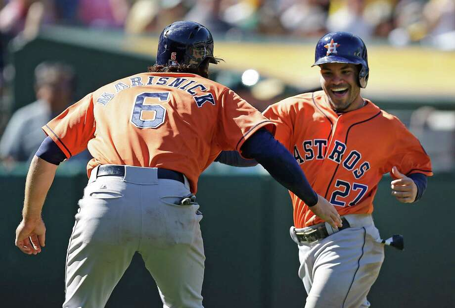 Jake Marisnick (6) and Jose Altuve scored the tying and go-ahead runs against the A's on Evan Gattis' double in the ninth inning. Photo: Ben Margot, STF / AP
