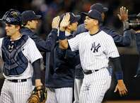 New York Yankees designated hitter Alex Rodriguez celebrates with teammates after the Yankees defeated the New York Mets 6-4 in a baseball game at Yankee Stadium in New York, Sunday, April 26, 2015.  New York Yankees catcher John Ryan Murphy is at left. (AP Photo/Kathy Willens) ORG XMIT: NYY119