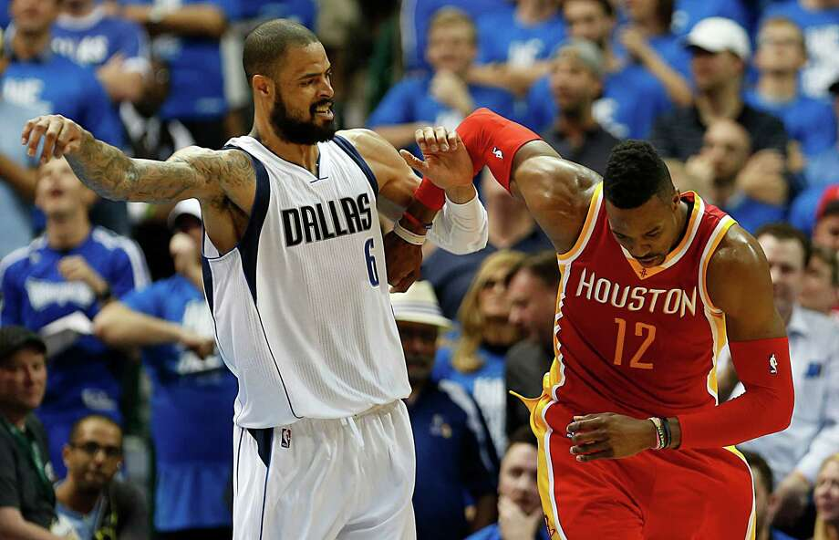 The Mavs' Tyson Chandler, left, and the Rockets' Dwight Howard tangle as more than 500 pounds of NBA centers mix it up for a double technical in the second half. Photo: James Nielsen, Staff / © 2015  Houston Chronicle