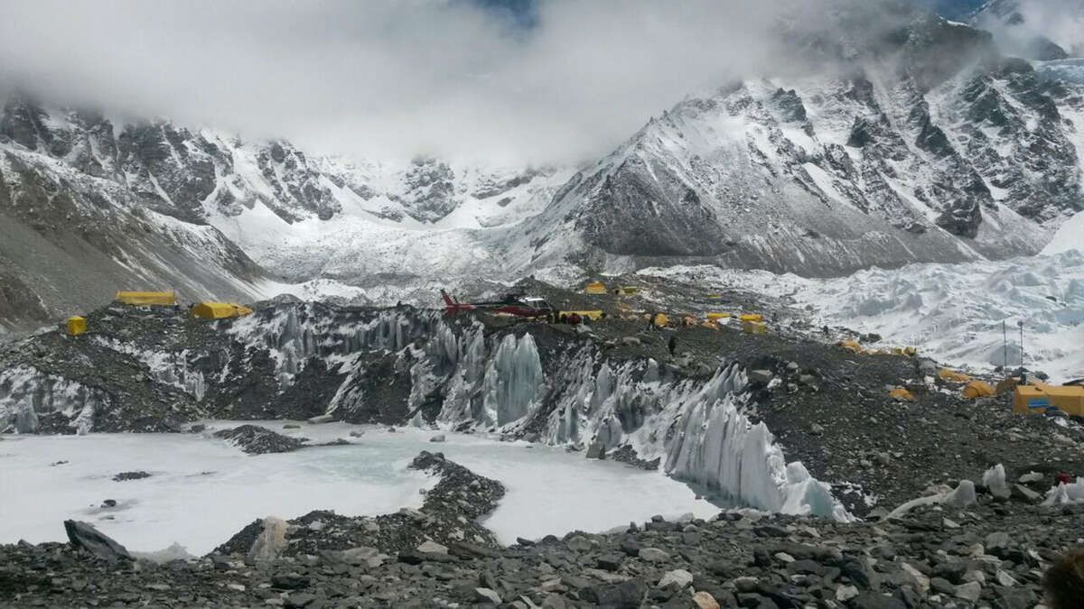 A rescue chopper prepares to land, carrying people from higher camps to Everest Base Camp, Nepal, Monday, April 27, 2015. An avalanche on Saturday, set off by the massive earthquake that struck Nepal, left more than a dozen people dead and dozens more injured.