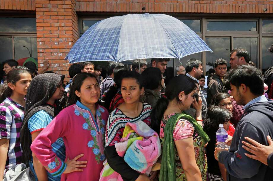 Indian tourists wait in a queue to be evacuated by special Indian Air Force plane at the Nepal International airport in Kathmandu, Nepal, Monday, April 27, 2015. A strong magnitude earthquake shook Nepal's capital and the densely populated Kathmandu valley on Saturday devastating the region and leaving tens of thousands shell-shocked and sleeping in streets. Photo: Manish Swarup, AP / AP