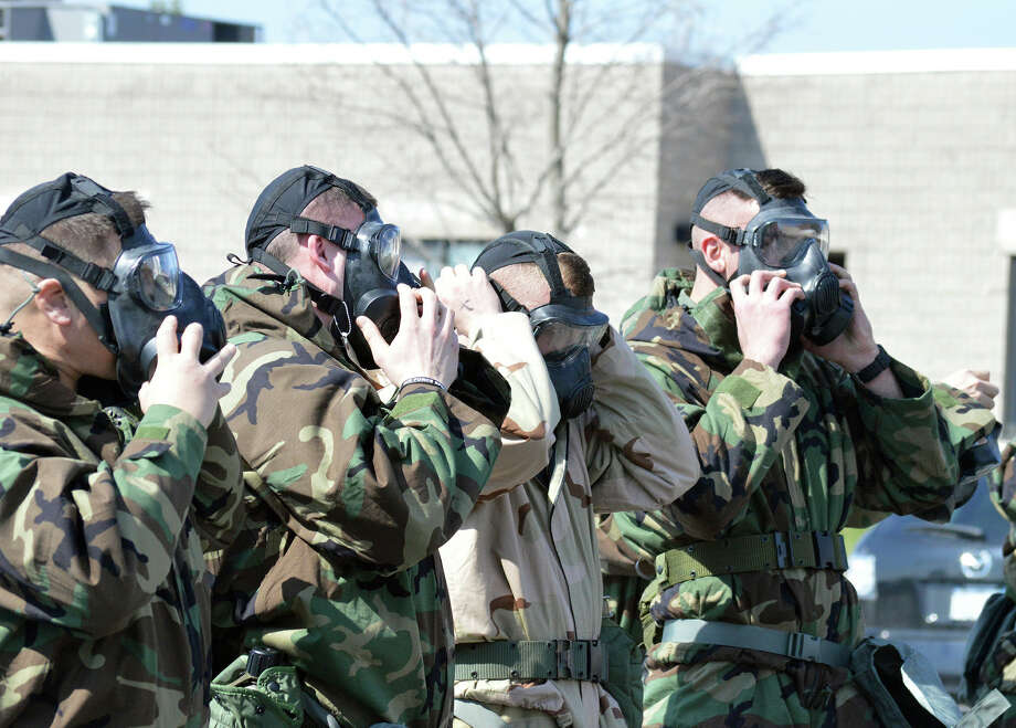 U.S. Air National Guard photo by Tech. Sgt. Catharine Schmidt/Released STRATTON AIR NATIONAL GUARD BASE--Airmen don their masks during the hands-on chemical, biological, radiological and nuclear training at Stratton Air National Guard Base, New York, on April 18, 2015. The training was part of the 109th Airlift Wing?s first ancillary training rodeo where more than 200 Airmen were trained on CBRN as well as self-aid and buddy care.