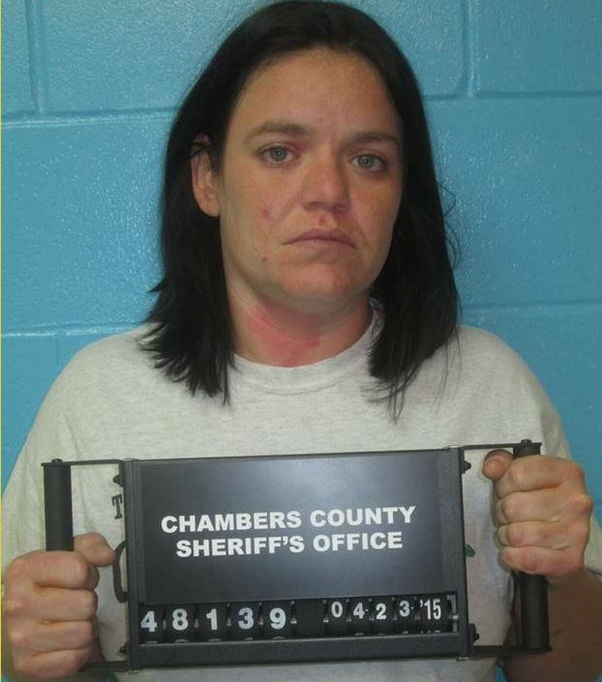 Laura Marie Meyer, 33, of Anahuac, is charged with theft, April 27, 2015.