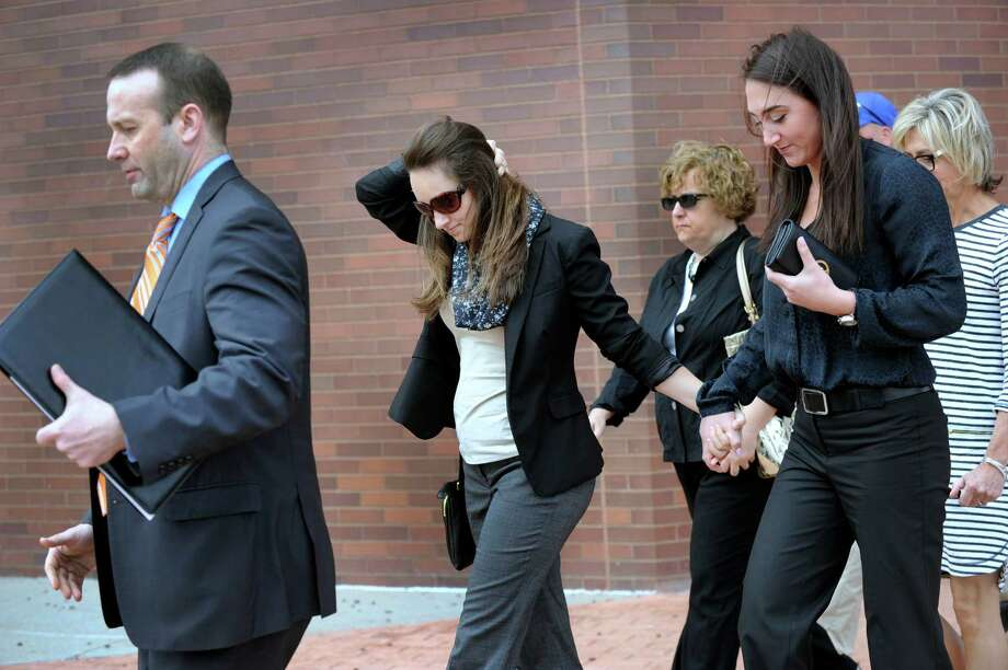 Kayla Mooney, second from left,  leaves Danbury Superior Court with her attorney and supporters Monday morning, April 27, 2015. Mooney, a Danbury High School teacher, is charged with the sexual assault of a 17-year-old student. Photo: Carol Kaliff / The News-Times
