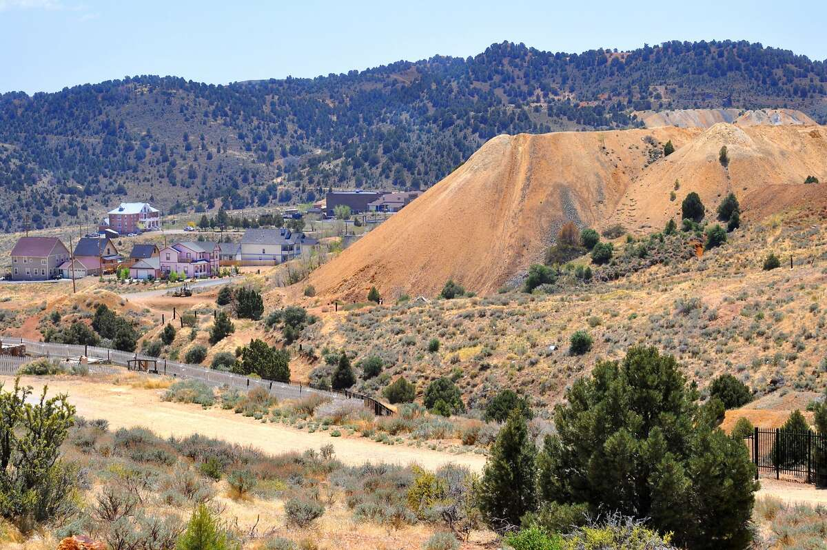 Large piles of tailings from long-abandoned gold and silver mines are seen throughout Virginia City, Nevada, a gold and silver mining boomtown in the 1850s and 1860s.