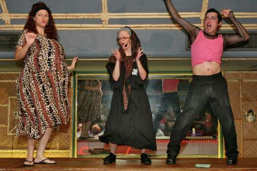 Aug. 26, 2006: From left to right, cast members Martha Evans (Janless Soaprano), Pam Hollenshead (mama), and Sam Martinez (Petey Soaprano) do the twist during The Soapranos dinner show. Photo: Bill Olive, FOR THE CHRONICLE / FREELANCE
