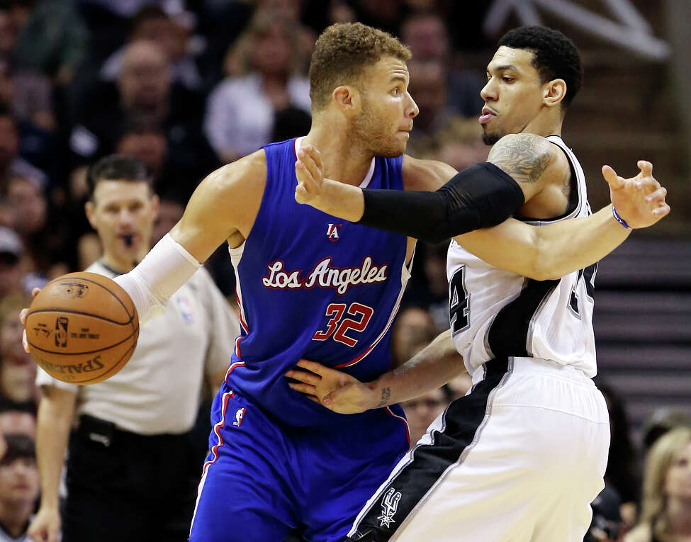 Los Angeles Clippers' Blake Griffin looks for room around San Antonio Spurs' Danny Green during second half action of Game 4 in the Western Conference playoffs Sunday April 26, 2015 at the AT&T Center. The Clippers won 114-105.