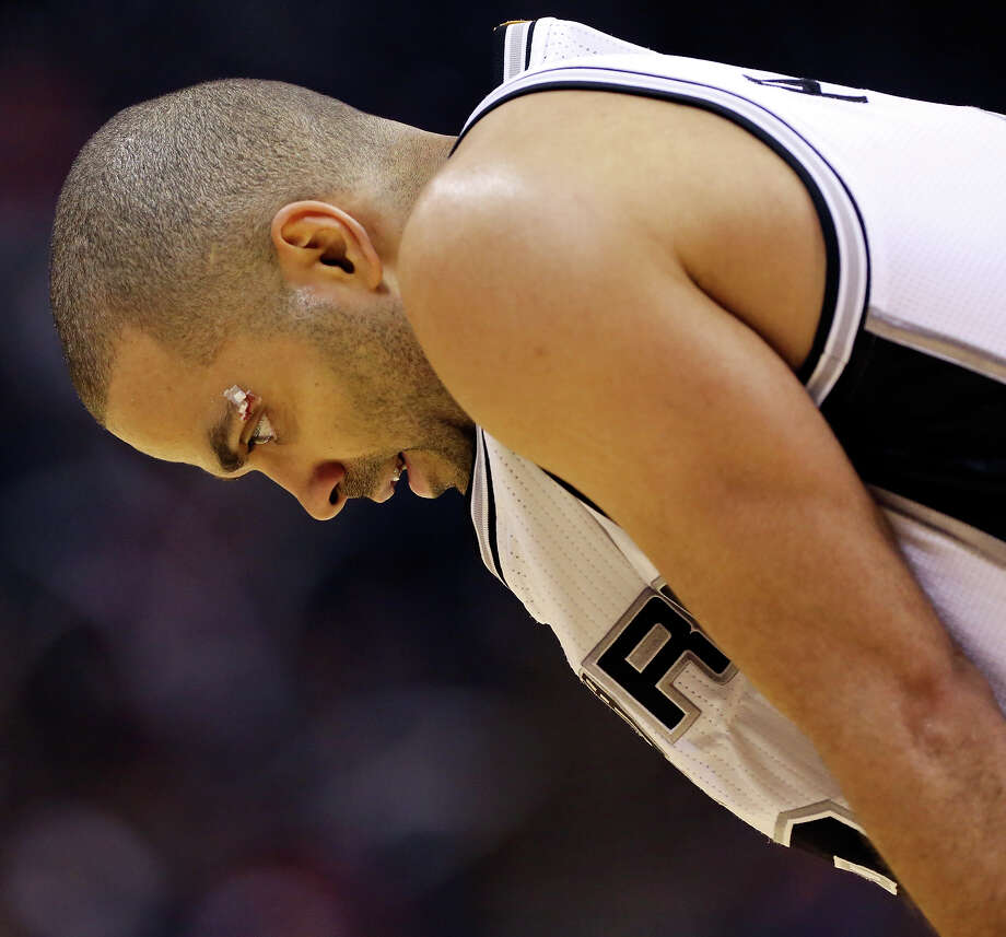 San Antonio Spurs' Tony Parker pauses during a timeout in second half action of Game 4 in the Western Conference playoffs against the Los Angeles Clippers Sunday April 26, 2015 at the AT&T Center.  The Clippers won 114-105. Photo: Edward A. Ornelas, San Antonio Express-News / © 2015 San Antonio Express-News