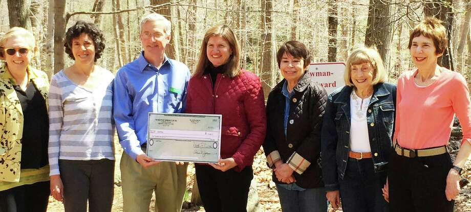 Earthplace received a $5,000 grant  from the Westport Womanís Club for its trails system. The presentation was made on Earth Day by Nancy Saipe, the clubís community services chair. Shown in the photo are, from left:  Dorothy Curran, WWC president; Lisa Shufro, Earthplace trustee and grounds chair; Tony McDowell, Eartplace executive director; Saipe; and Mary Lee Clayton, Jo Fuchs-Luscombe and Arlene Thrope, members of the community services committee. . Photo: Contributed Photo / westport news